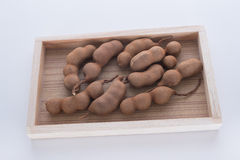 Tamarindo doce na bandeja de madeira Imagens de Stock Royalty Free