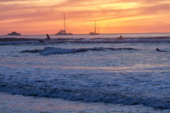 Tamarindo Surfing at Sunset Stock Photo