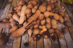 Tamarindos (tamarinds) on kitchen table Stock Photos