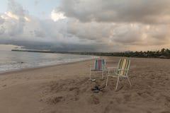 Tambau海滩-在海滩的椅子-日出 免版税库存照片