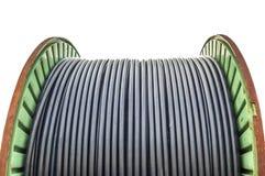 Tambor de cable contra blanco Fotografía de archivo