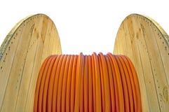 Tambor de cable con el cable anaranjado Imágenes de archivo libres de regalías