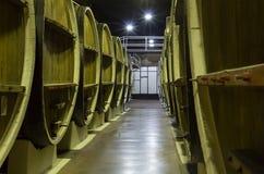 Tambores de madeira em uma base de pedra em um repositório leve Fotografia de Stock Royalty Free