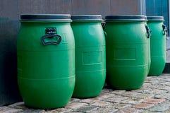 Tambores plásticos verdes velhos grandes Fotografia de Stock Royalty Free