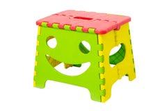 Tamborete de dobramento plástico colorido Foto de Stock