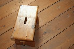 Tamborete de madeira no fundo de madeira Fotografia de Stock Royalty Free