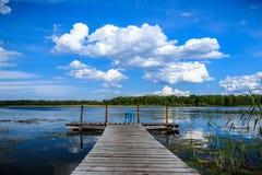Tamborete no cais do lago Imagens de Stock
