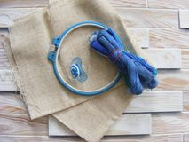 Tambour with threads for embroidery blue color and pacifiers Stock Photos
