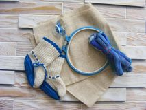 Tambour with threads for embroidery with pacifiers and baby shoes Royalty Free Stock Photos