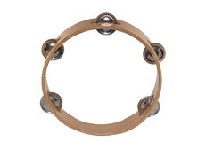 Tambourine. The tambourine is a musical instrument in the percussion family consisting of a frame, often of wood or plastic, with pairs of small metal jingles royalty free stock photography