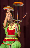 A Tambourine Dancer performs at the Esala Perahara theatre show in Kandy, Sri Lanka. Stock Photos