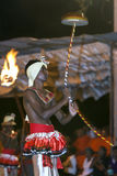 A Tambourine Dancer (Rabun Nettuwo) performs along the streets of Kandy during the Esala Perahera in Sri Lanka. Stock Photography