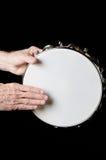 Tambourine gespielt auf Schwarzem Stockfotos