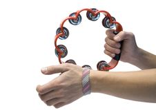 Tambourine in hands Royalty Free Stock Image