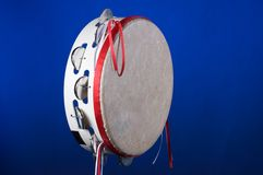 Tambourine Isolated on Blue Royalty Free Stock Images