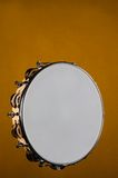 Tambourine Isolated on Gold Royalty Free Stock Images