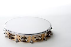 Tambourine Isolated White Bk. A round shaped maple wood Tambourine closeup isolated against a high key white background in the horizontal or landscape  view Royalty Free Stock Photos