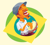 Tambourine player popping up of brazilian flag Stock Photo