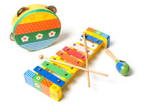 Tambourine, rattle and xylophone. Musical instruments on white background Royalty Free Stock Images