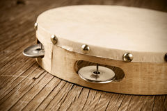 Tambourine on a rustic wooden table, retro look Stock Photos