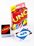 Two decks of UNO game cards with UNO game box on white backgroun Stock Photo