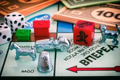Monopoly Board Game. Field Go of gameboard with tokens, dices, m Royalty Free Stock Photography