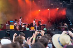 Tame Impala band in concert at Rock En Seine Festival. PARIS - AUG 31: Tame Impala band in concert at Rock En Seine Festival on August 31, 2015 in Paris, France Stock Photography