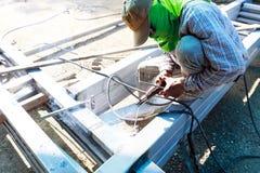 Tame welder. the welder welds iron. Royalty Free Stock Photos