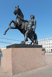 Tamer of horses. Sculpture tamer of horses, work of the sculptor Baron Peter Clodt on the famous Anichkov Bridge, St. Petersburg, Russia, 1841 Stock Image
