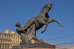 Tamer of Horses in St. Petersburg. Tamer of Horses of Peter Clodt on Anichkov bridge in St. Petersburg, Russia Stock Photo