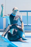 Tamer with a sea seal Stock Images