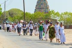 Tamil hindu temple in Jaffna, North Sri Lanka. Jaffna, North Lanka - August 19, 2012: Crowd of devotees walking at Naga Pooshani Amman, tamil hindu temple on the Royalty Free Stock Photography