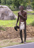 Tamil man walks with only a loin-cloth. Royalty Free Stock Photos