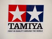 Tamiya Incorporated японский изготовитель пластичных модельных наборов, передает контролируемые автомобили по радио клеймя логоти Стоковая Фотография