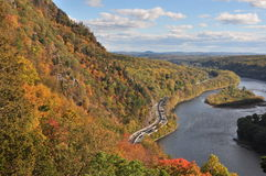 Tammany mountain at Delaware Water gap in autumn. Foliage autumn colors, Tammany mountain, New Jersey, landscape, Delaware river,  Water gap, blue sky clouds Royalty Free Stock Photos