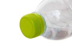 Tampão verde da garrafa plástica isolado no backgroun branco Foto de Stock Royalty Free