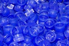 Tampões de frasco plásticos azuis fotos de stock