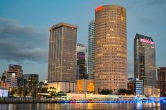 Illuminated Tampa Riverwalk and modern buildings on sunset background in downtown area. royalty free stock images
