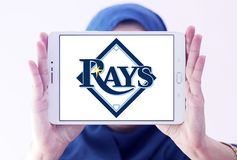 Tampa Bay Rays baseball team logo. Logo of Tampa Bay Rays team on samsung tablet holded by arab muslim woman. The Tampa Bay Rays are an American professional Royalty Free Stock Photo