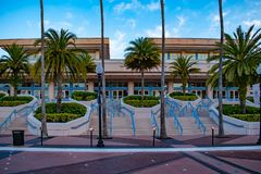 Tampa Convention Center and palm trees on sunrise background 2 royalty free stock photo