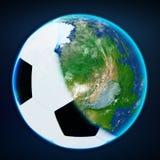 Tampa da bola do futebol a terra do planeta ostenta o mundo Imagens de Stock