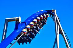 Funny people in seats of steel roller coaster trains climbing to a higher place on blue steel trail at Bush Gardens. Tampa, Florida. December 26, 2018 Funny royalty free stock photography