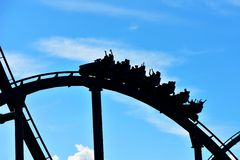 Beautiful silhouette of Shetaah Hunt Rollercoaster on sunset background at Bush Gardens Tampa Ba stock photo