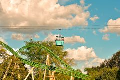 Couple enjoying Skyride attraction. Panoramic view of Cheetah Hunt and beatiful forest on blue royalty free stock photography