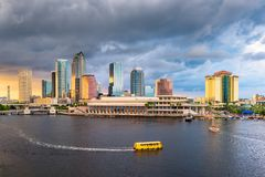Tampa, Florida, USA downtown skyline on the bay. At dusk with water traffic stock photo