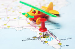 Tampa Florida USA map airplane. Close up of Tampa Florida USA map with red pin and airplane toy - Travel concept royalty free stock photography