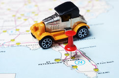 Tampa Florida USA map retro car. Close up of Tampa Florida USA map with red pin and retro car toy - Travel concept royalty free stock images