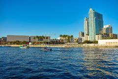 Tampa Museum of Art , skycrapers and boats sailing on Hillsborough river in downtown area . royalty free stock images