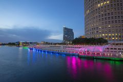 Tampa Riverwalk. At night, with the Tampa Bay Performing Arts Center in the distance, with lights and reflections on the Hillsborough river Stock Images