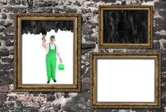 Tampas do pintor de casa dentro de três quadros Foto de Stock